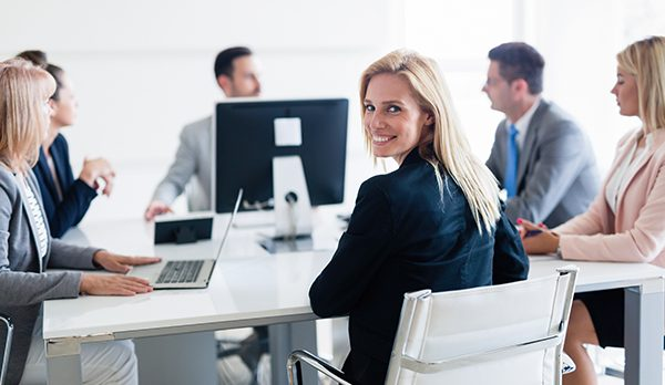 Picture of attractive smiling saleswoman on meeting in office